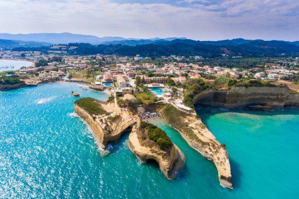 Canal D'Amour beach in Sidari, Corfu island, Greece. People bathing in the sun. Turqoise water.